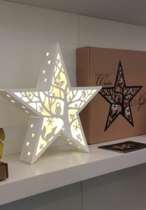 White wooden winter star light displayed on shelf Thinkgadgets AuraDecor Designs